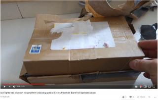 darts paket wird ausgepackt
